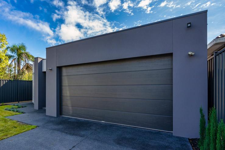 Insulated sectional garage door. Flatline, Monument®