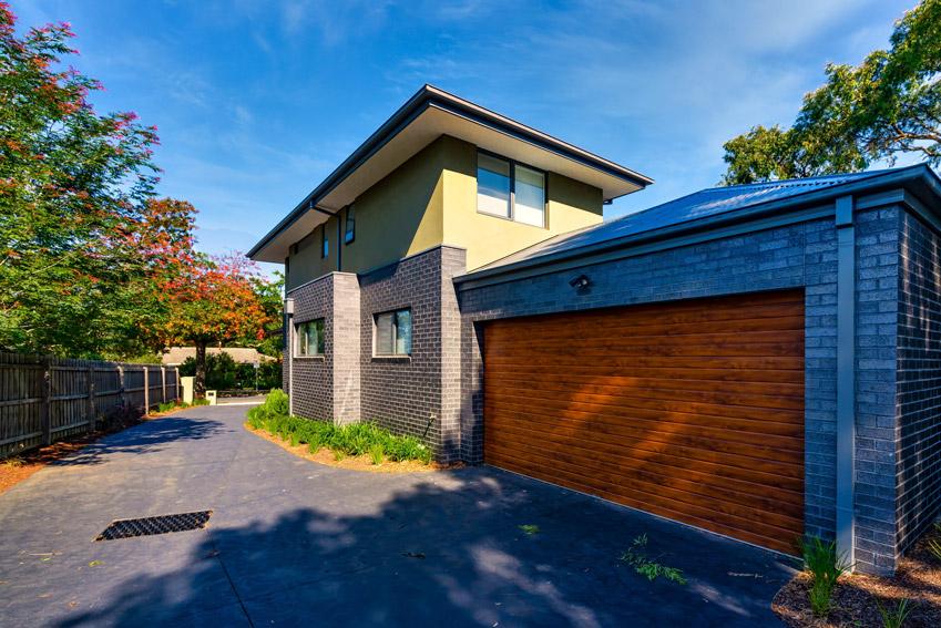 Insulated sectional garage door. Ribline, Portabella Finish (Golden Oak)